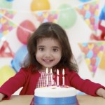 Child with birthday cake